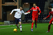 Preston North End Striker Joe Garner races away from Charlton Athletic midfielder Jordan Cousins (8) during the Sky Bet Championship match between Preston North End and Charlton Athletic at Deepdale, Preston, England on 23 February 2016. Photo by Pete Burns.