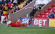 Charlton Tal Ben Hailm sliding tackle to Leeds United Player Alex Mowatt during the Sky Bet Championship match between Charlton Athletic and Leeds United at The Valley, London, England on 18 April 2015. Photo by Ricky Swift.
