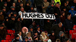 File photo dated 01-01-2018 of Stoke City fans hold up a 'Hughes Out' banner in the stands after Newcastle United's Ayoze Perez scores an opening goal during the Premier League match at the bet365 Stadium, Stoke.