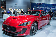 New York, NY - 1 April 2015. A red Maserati Gran Turismo MC Centennial is shown at the New York International Auto Show. The Centennial edition, with unique styling features, is being produced in 2015 only, marking the 100th year of Maserati.