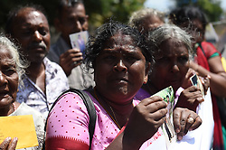 JAFFNA, Sept. 3, 2016 (Xinhua) -- Sri Lankan people hold banners and images of their family members who had disappeared during and after the civil conflict, at a silent protest outside the Jaffna Library in Jaffna, Sri Lanka, Sept. 2, 2016. Hundreds of relatives of those missing during and after Sri Lanka's civil conflict on Friday urged UN Secretary-General Ban Ki-moon to launch an international probe to find their whereabouts. The UN secretary-general, who is on the final leg of his two-day official visit to the island nation, visited former war-torn Jaffna on Friday afternoon where he visited a resettlement site and met with displaced people. (Xinhua/A. Rajhitah).****Authorized by ytfs* (Credit Image: © A. Rajhitah/Xinhua via ZUMA Wire)
