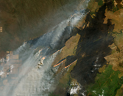 August 27, 2019 - Paraguay - Imager Released Today, SWIR overlay: Since the beginning of August 2019, NASA satellites have observed several fires near the border of Bolivia, Paraguay, and Brazil. (Note that this area is not in the Amazon rainforest.) On August 25, 2019, the Operational Land Imager (OLI) on Landsat 8 acquired images of one of the larger fires, which was burning north of the Paraguay River near Puerto Busch. The first image was made using OLI bands 4-3-2 (visible light). The second image includes observations of shortwave-infrared light in order to highlight the active fire. Recently burned areas appear black. (Credit Image: © NASA/ZUMA Wire/ZUMAPRESS.com)