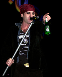 """Quireboys lead singer """"Spike"""" (Jonathan Gray) performing on stage at the  Monsters of Rock Festival. The last night of an eleven date tour at the Hallam FM Arena, Sheffield on Tuesday 26th November<br /> <br /> Copyright Paul David Drabble<br /> Freelance Photographer<br /> 07831 853913<br /> 0114 2468406<br /> www.pauldaviddrabble.co.uk<br /> [#Beginning of Shooting Data Section]<br /> Nikon D1 <br /> 2002/11/26 20:13:58.4<br /> JPEG (8-bit) Fine<br /> Image Size:  2000 x 1312<br /> Color<br /> Lens: 80-200mm f/2.8-2.8<br /> Focal Length: 135mm<br /> Exposure Mode: Manual<br /> Metering Mode: Spot<br /> 1/250 sec - f/2.8<br /> Exposure Comp.: 0 EV<br /> Sensitivity: ISO 400<br /> White Balance: Auto<br /> AF Mode: AF-S<br /> Tone Comp: Normal<br /> Flash Sync Mode: Front Curtain<br /> Auto Flash Mode: External<br /> Color Mode: <br /> Hue Adjustment: <br /> Sharpening: Normal<br /> Noise Reduction: <br /> Image Comment: <br /> [#End of Shooting Data Section]"""