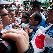 TOKYO, JAPAN - JULY 1: Anti-Abe protesters clash with Japanese police during the speech of Japanese Prime Minister Shinzo Abe for his candidate Aya Nakamura of main opposition, Liberal Democratic Party (LDP) in Akihabara, Tokyo, Japan on July 1, 2017. Tokyo Metropolitan Assembly election will be held on July 2. (Photo: Richard Atrero de Guzman/NUR Photo)
