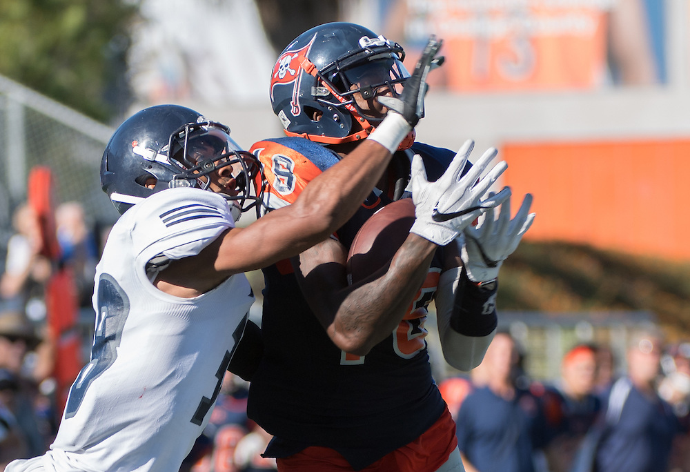 James Rutledge#18 from Orange Coast College catches a deep pass over TimGordon#38 of Fullerton College on Saturday November 5