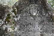 Carved face on a Lycian sarcophagus tomb at the acropolis at Sydima, a Lycian site at Dorduga village, Fethiye, Antalya, Turkey. The ruins here date from the earliest classical Lycian period around the 5th century BC, although many of the remaining structures are Roman. Picture by Manuel Cohen