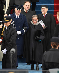 Supreme Court Justice Ruth Bader Ginsburg is escorted to her seat during the Inauguration Ceremony of President Donald Trump on the West Front of the U.S. Capitol on January 20, 2017 in Washington, D.C. Trump became the 45th President of the United States. Photo by Pat Benic/UPI