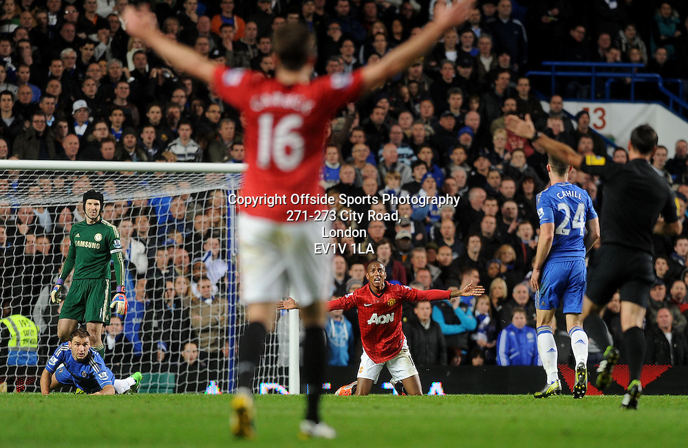 28/10/2012 - Barclays Premier League Football - 2012-2013 - Chelsea v Manchester United - Chelsea's Branislav Ivanovic (L) fouls Ashley Young of United (R) and is sent off. - Photo: Charlie Crowhurst / Offside.