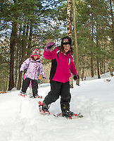 Madison Monier and Katie Westcott enjoyed snowshoeing for their very first time out on the Forest Trail at Prescott Farm during Winter Fest activities Saturday afternoon.  (Karen Bobotas/for the Laconia Daily Sun)