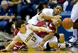 February 13, 2010; Berkeley, CA, USA;  Washington State Cougars guard Reggie Moore (3) and California Golden Bears guard Nikola Knezevic (13) battle for a loose ball during the first half at the Haas Pavilion.  California defeated Washington State 86-70.