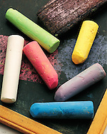 still life of colored chalks on a blackboard<br /> with an eraser