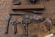 Blacksmith metal working tools at a iron working shop in Charleston, SC