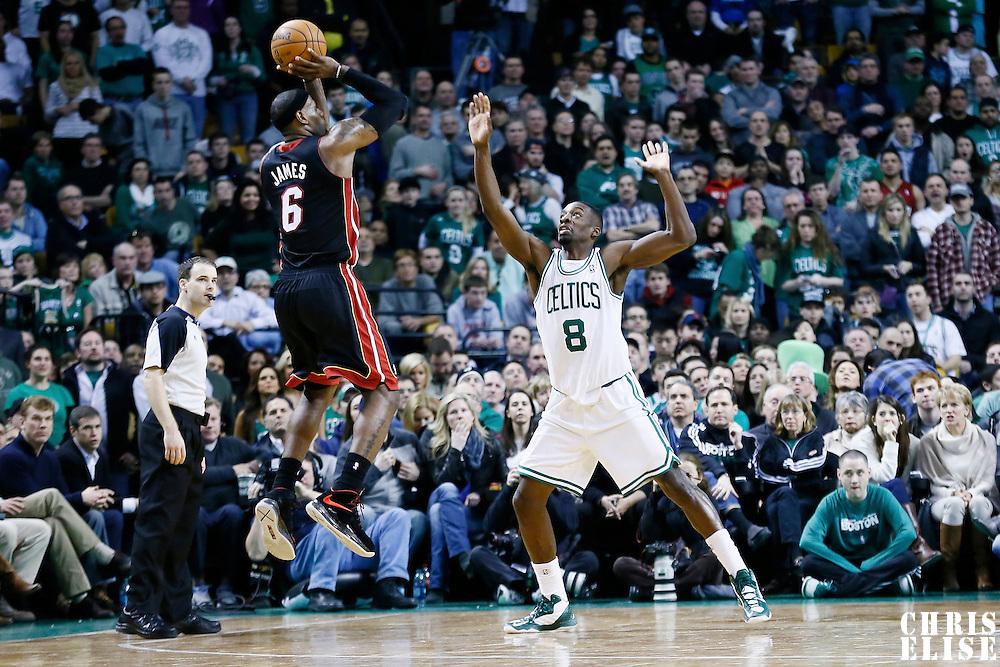27 January 2013: Miami Heat small forward LeBron James (6) takes a jumpshot over Boston Celtics power forward Jeff Green (8) during the Boston Celtics 100-98  2OT victory over the Miami Heat at the TD Garden, Boston, Massachusetts, USA.