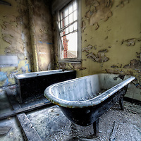 Dirty baths at Hellingly Asylum, East Sussex.