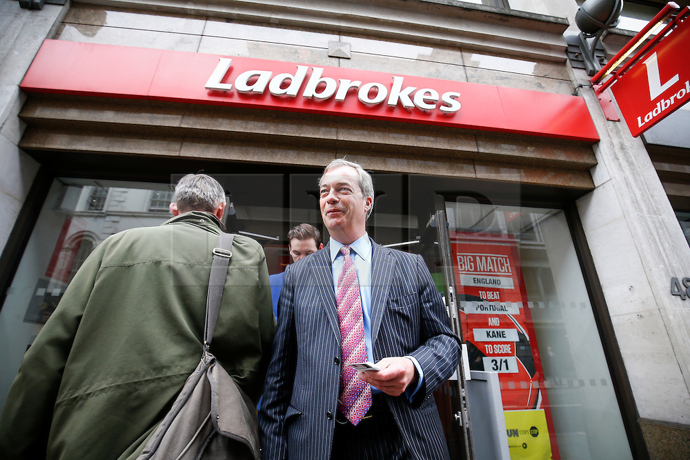 © Licensed to London News Pictures. 02/06/2016. London, UK. UKIP leader NIGEL FARAGE visits a Ladbrokes betting shop in the City of London on Thursday, 2 June 2016, to campaign for Brexit ahead of the June 23rd EU referendum. Photo credit: Tolga Akmen/LNP