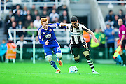 Newcastle United forward Ayoze P?rez (#17) takes on Brentford midfielder Ryan Woods (#15) during the EFL Sky Bet Championship match between Newcastle United and Brentford at St. James's Park, Newcastle, England on 15 October 2016. Photo by Craig Doyle.