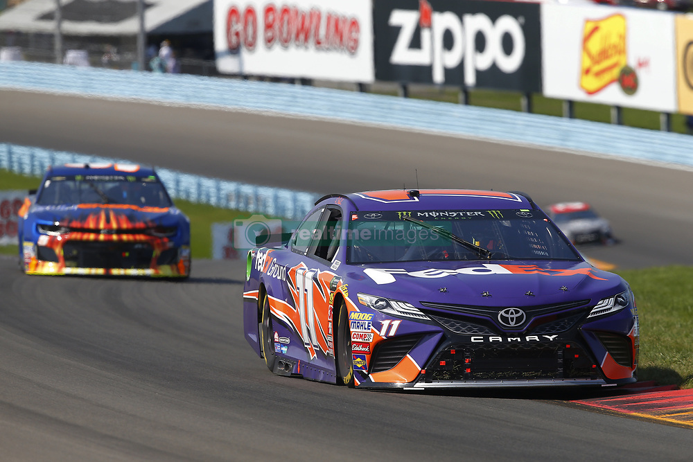 August 5, 2018 - Watkins Glen, New York, United States of America - Denny Hamlin (11) brings his car through the turns during the Go Bowling at The Glen at Watkins Glen International in Watkins Glen , New York. (Credit Image: © Chris Owens Asp Inc/ASP via ZUMA Wire)