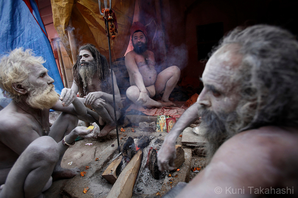 Sadhus (holy men) smoke at their camp in Haridwar, India on Feb 2010 during Kumb Mela, largest Hindu gathering in the world. Hindus believe that bathing in the Ganges during the festival cleanses them of sin. Photo by Kuni Takahashi.