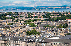 View over rooftops of the New Town towards the Forth Estuary in Edinburgh, Scotland, United Kingdom