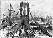 Brooklyn Suspension Bridge, New York, designed and built by John Augustus Roebling (1806-1869) and his son Washington Augustus Roebling (1837-1926). Opened 1883.  Cable anchorage on the Brooklyn shore. Engraving 1883.