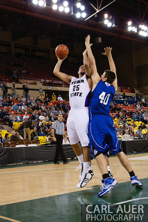 November 27th, 2010:  Anchorage, Alaska - Weber State freshman forward Byron Fulton (25) attempts a one handed shot in the Weber State 82-81 victory over the Drake Bulldogs in the third place game of the Great Alaska Shootout.