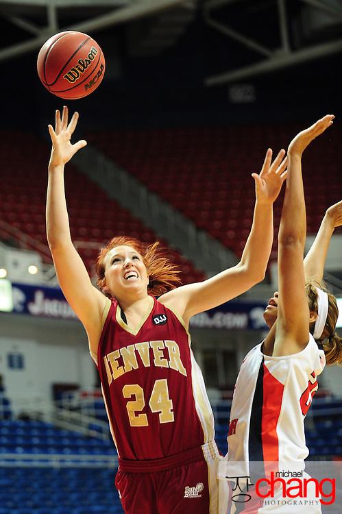 Denver's forward, Kaetlyn Murdoch (24), shoots around South Alabama's guard, Mary Nixon (23),  in the second half of play in Mobile, AL. South Alabama defeated Denver 57-51 on Jan 7, 2012...