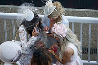 National Hunt Horse Racing - 2017 Randox Grand National Festival - Saturday, Day Three [Grand National Day]<br /> <br /> Female racegoers with smartphones  the 2nd race the 2.25 the Betway Mersey Novices' Hurdle  at Aintree Racecourse.<br /> <br /> COLORSPORT/WINSTON BYNORTH