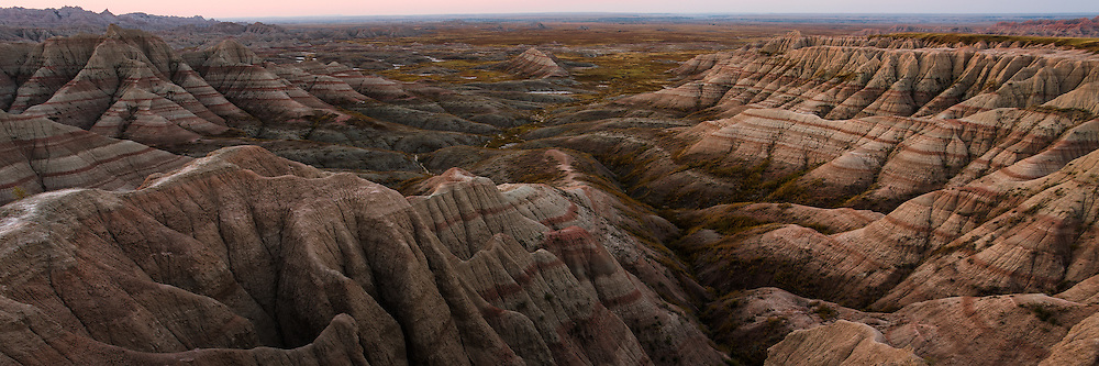 The Badlands of South Dakota is a fascinating place to explore. These hills, are the remains of millions of years of deposited mineral layers building up then going through the process of erosion. If you look closely you can see the veins of the  hills - these stripes represent a timeline of history from top to bottom - though, they look like a real-life Topography map of the terrain. In many of these layers, fossils can be found, but often are not discovered until they are washed out from infrequent rains. While there are several official trails, you really could wander anywhere through the canyons and discover new shapes and features among the gullies.