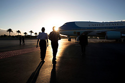 President Barack Obama walks to Air Force One with Gen. Lori Robinson, Pacific Air Forces Commander, following a refueling stop at Joint Base Pearl Harbor-Hickam in Hawaii, Nov. 16, 2014. (Official White House Photo by Pete Souza)<br /> <br /> This official White House photograph is being made available only for publication by news organizations and/or for personal use printing by the subject(s) of the photograph. The photograph may not be manipulated in any way and may not be used in commercial or political materials, advertisements, emails, products, promotions that in any way suggests approval or endorsement of the President, the First Family, or the White House.