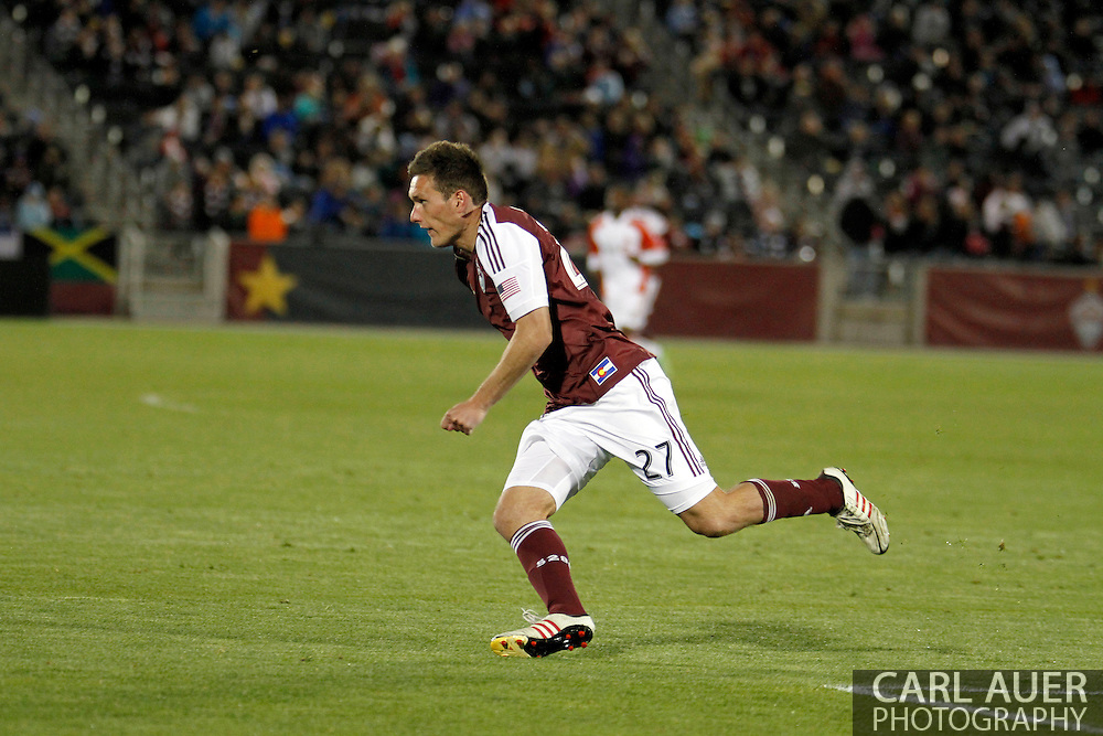 May 4th, 2013 Commerce City, CO - Colorado Rapids midfielder Shane O'Neill (27) chases after the ball in the second half of the MLS match between the Toronto FC and the Colorado Rapids at Dick's Sporting Goods Park in Commerce City, CO