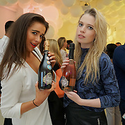 London,England,UK, 11th Aug 2016 : Geo Rushby,Ella Walsh attend the wine retailer hosts summer party to sample its award-winning sparkling wine range at Icetank Studios, Lo0ndon,UK. Photo by See Li