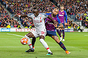Liverpool striker Sadio Mane (10) goes past Barcelona defender Arturo Vidal (22) and is fouled during the Champions League semi-final leg 1 of 2 match between Barcelona and Liverpool at Camp Nou, Barcelona, Spain on 1 May 2019.