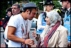 EDL supporter talks to a muslim woman before the protest against what the EDL sees as the influence of Islam in the Tower Hamlets area of London, United Kingdom. Saturday, 7th September 2013. Picture by Piero Cruciatti / i-Images