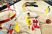 ANN ARBOR, MI - FEBRUARY 5: Aaron Craft #4 of the Ohio State Buckeyes goes to the basket against Trey Burke #3 of the Michigan Wolverines during the game at Crisler Center in Ann Arbor, Michigan on February 5. Michigan won 76-74. (Photo by Joe Robbins)