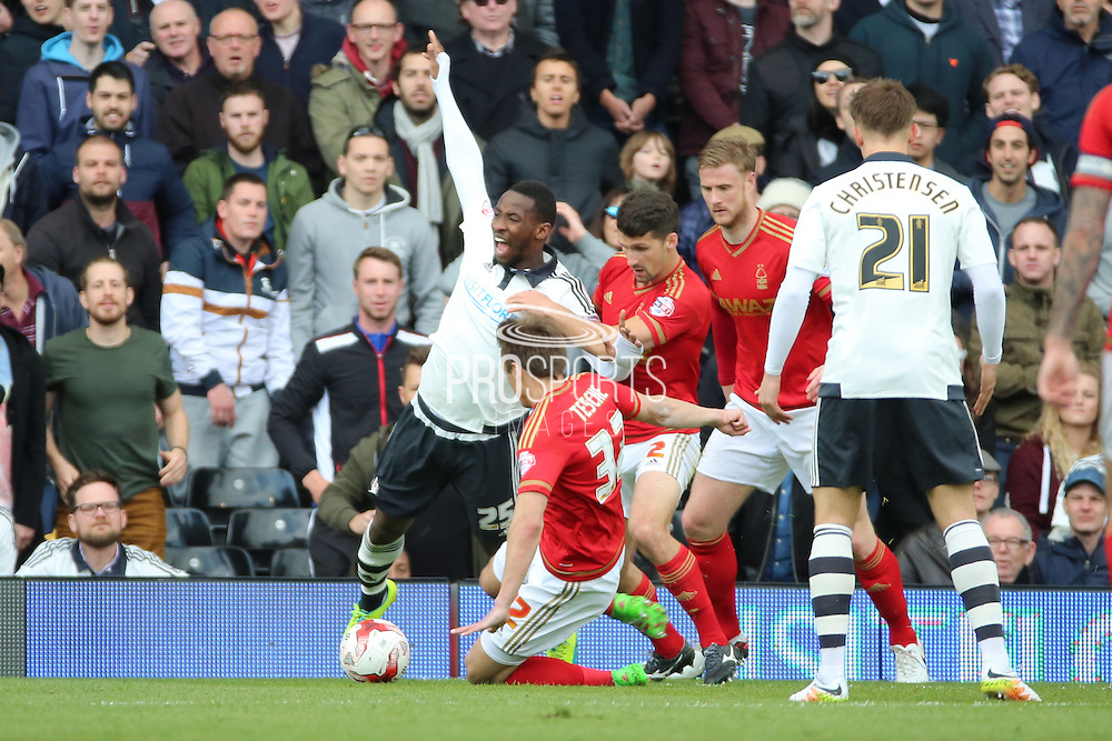 Nottingham Forest midfielder Robert Tesche (32) tackling Fulham striker, Moussa Dembele (25) during the Sky Bet Championship match between Fulham and Nottingham Forest at Craven Cottage, London, England on 23 April 2016. Photo by Matthew Redman.
