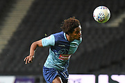 Wycombe Wanderers defender Sido Jambati (2) heads the ball during the EFL Trophy match between Milton Keynes Dons and Wycombe Wanderers at stadium:mk, Milton Keynes, England on 12 November 2019.