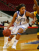 Rachel Butler of Hampton drives to the basket against arch rival Norfolk State during the 2006 MEAC Basketball Tournament in Raleigh, North Carolina.  03/07/06  (Photo by Mark W. Sutton)