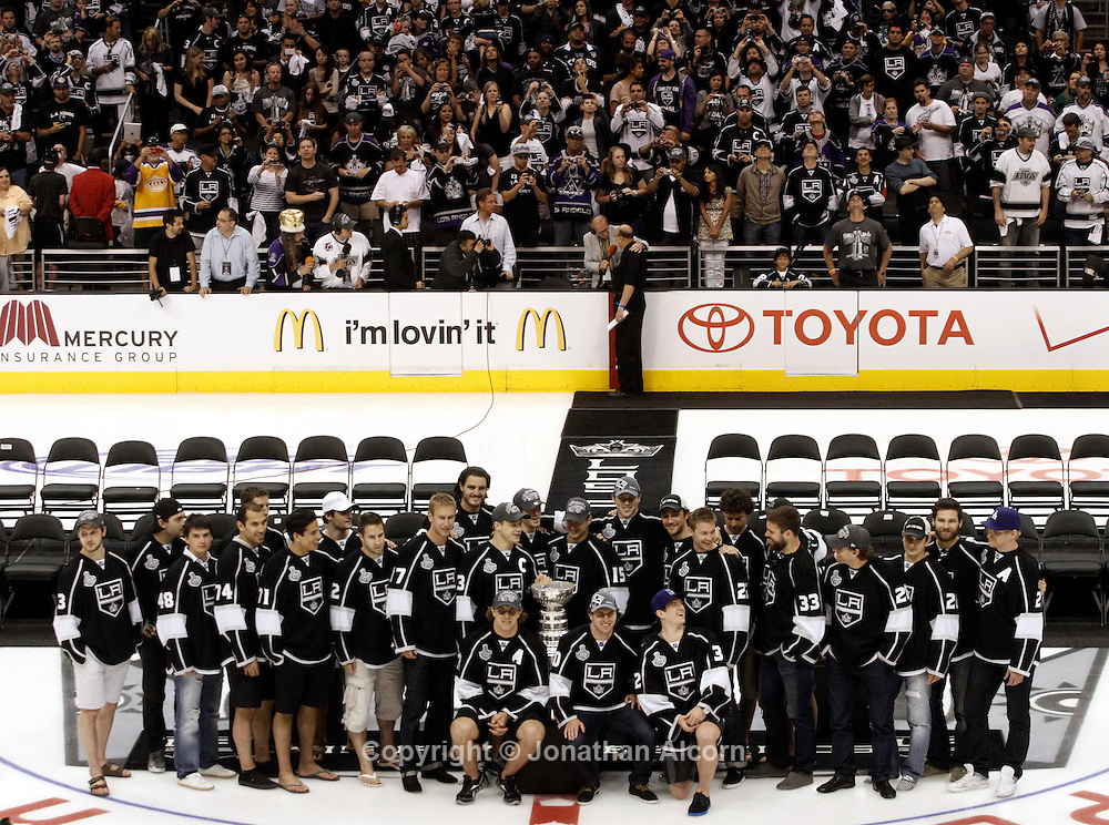 Los Angeles Kings players gather for a photo with the Stanley Cup during a rally honoring the Stanley Cup champions at Staples Center in downtown Los Angeles on June 14, 2012.