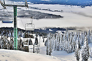USA, Idaho, Valley County, Tamarack Resort, Ski Lift from atop West Mountain, Long Valley and town of Donnelly below