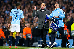 Manchester City manager Pep Guardiola speaks to Raheem Sterling of Manchester City - Mandatory by-line: Robbie Stephenson/JMP - 17/04/2019 - FOOTBALL - Etihad Stadium - Manchester, England - Manchester City v Tottenham Hotspur - UEFA Champions League Quarter Final 2nd Leg