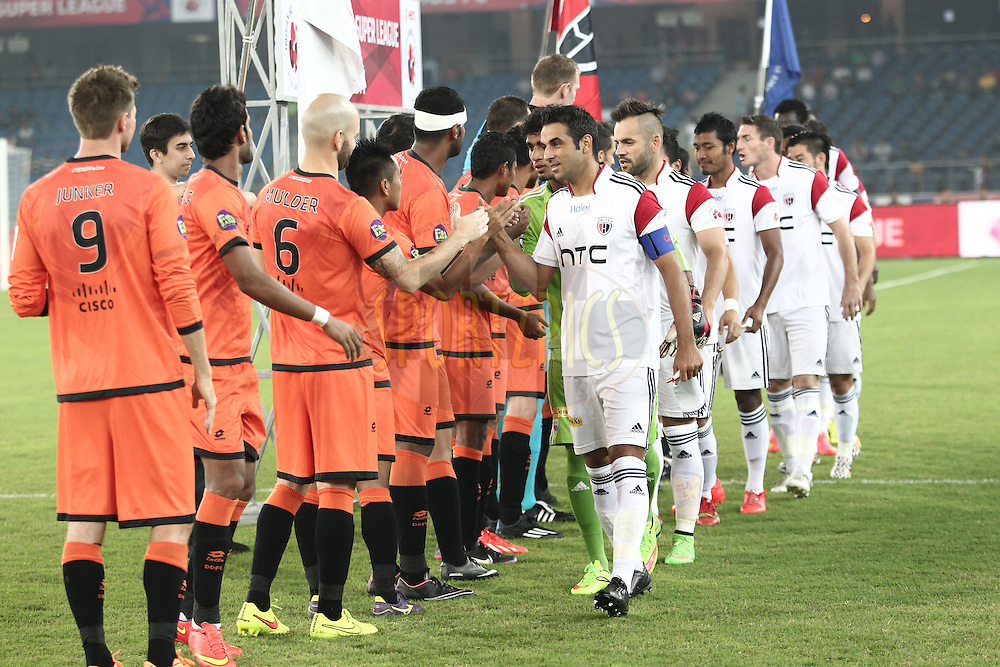Delhi Dynamos FC and NorthEast United FC both team during hand shake before the match 16 of the Hero Indian Super League between The Delhi Dynamos FC and NorthEast United FC held at the Jawaharlal Nehru Stadium, Delhi, India on the 29th October 2014.<br /> <br /> Photo by:  Deepak Malik/ ISL/ SPORTZPICS