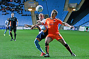 Coventry City midfielder, on loan from Dagenham & Redbridge, Jodi Jones (45) clears the dangers ahead of Colchester United defender Nicky Shorey (31)   during the Sky Bet League 1 match between Coventry City and Colchester United at the Ricoh Arena, Coventry, England on 29 March 2016. Photo by Simon Davies.