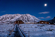 Tateyama Murodo Sanso mountain hut in snow. At 2450 meters elevation, Murodo is the highest point along the Tateyama Kurobe Alpine Route, offering lodging, hiking and views of the Tateyama Mountain Range. The Tateyama Kurobe Alpine Route carries visitors across the Northern Japan Alps (Hida Mountains) via cablecars, trolley buses and a ropeway. Completed in 1971, this transportation corridor connects Toyama City in Toyama Prefecture with Omachi Town in Nagano Prefecture. The Tateyama Mountain Range lies within Chubu Sangaku National Park.