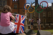 South Korean children stand for a souvenir photo on the Olympic rings that stand at the entrance of King Henry the Eighth's Hampton Court Palace on the first day of competition of the London 2012 Olympic 250km mens' road race. Starting from central London and passing the capital's famous landmarks before heading out into rural England to the gruelling Box Hill in the county of Surrey. Local southwest Londoners lined the route hoping for British favourite Mark Cavendish to win Team GB first medal but were eventually disappointed when Kazakhstan's Alexandre Vinokourov eventually won gold.