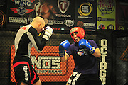 MMA training at Octagon in Dallas, Texas on September 30, 2014. (Photo by Cooper Neill)