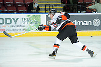 KELOWNA, CANADA, OCTOBER 11:  Tyler Lewington #5 of the Medicine Hat Tigers take a shot on net during warm-up as the Medicine Hat Tigers visited the Kelowna Rockets on October 11, 2011 at Prospera Place in Kelowna, British Columbia, Canada (Photo by Marissa Baecker/shootthebreeze.ca) *** Local Caption ***Tyler Lexington;
