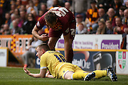 Bradford City defender Anthony McMahon (29)  and Millwall FC midfielder Shane Ferguson (18)  during the Sky Bet League 1 play off first leg match between Bradford City and Millwall at the Coral Windows Stadium, Bradford, England on 15 May 2016. Photo by Simon Davies.