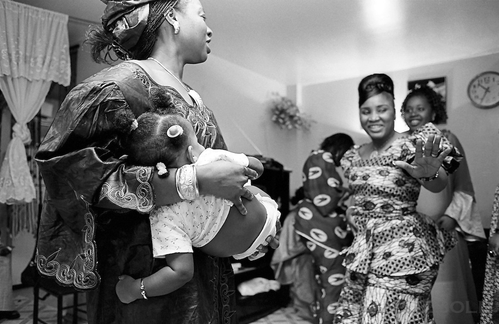 Women celebrating at a baptism in the Bronx.