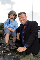 Entrepreneur and Dragons Den star Duncan Bannatyne and his seven year old son Tom pay a visit to the Queens Own Yeomanry on exercise at the Catterick training area North Yorkshire 25 July  Copyright Paul David Drabble