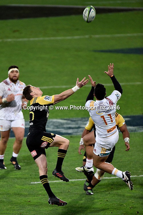 Hurricanes' Beauden Barrett (L) jumps for the ball with Chief's James Lowe during the Hurricanes vs Chiefs Super Rugby Semi Final match at the Westpac Stadium in Wellington on Saturday the 30th of July 2016. Copyright Photo by Marty Melville / www.Photosport.nz